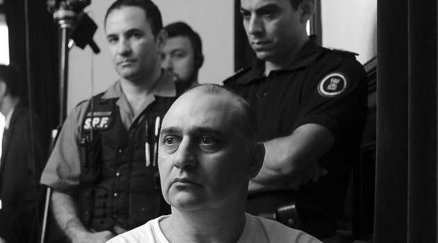Jorge Mangeri y policias - Télam